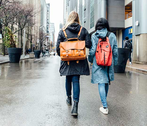 Two students walking down the street